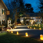 Prior to his annual holiday party, Kerry Kegerise decorates his home inside and out. On the evening of the party, he lines the driveway and walkways with luminaries.