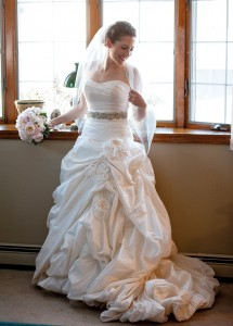 Megan's ballgown featured a form-fitting, ruched bodice, a sparling belt and a floral-embellished skirt.
