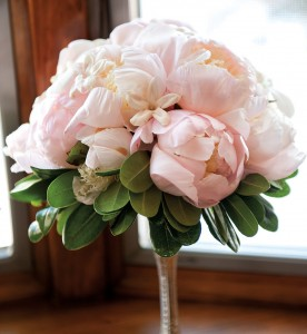 Megan and her sister carried similar bouquets composed of blush-hued peonies.