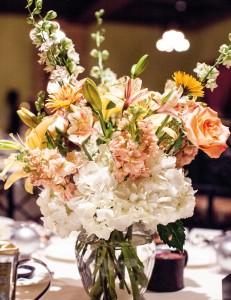 The salmon-and- white color scheme echoed floral arrangements.