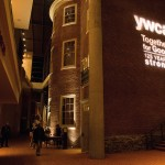 Gala logo and YWCA moniker lit the side of the Montgomery House, the historic home of the organization during the last decade of the 19th century.