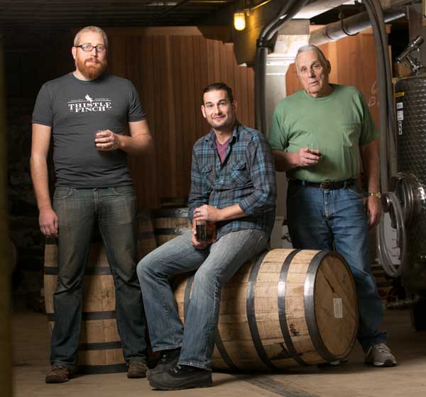Andrew Martin (left) of Thistle Finch Distillery provided the facility and assistance to blend the initial offering from Bomberger's Distillery. Revitalizing the historic brand is the vision of Erik Wolfe (center), Dick Stoll (right), and their wives, Avianna and Elaine (not pictured).