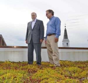 "Mayor Rick Gray (left) and Gordy Kautz survey the ""living roof"" that was installed atop Lancaster City Hall's 18,000-square-foot annex."