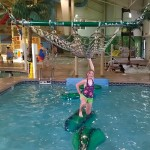 Halli Upton negotiates the alligator obstacle course at the Caribbean Indoor Water Park in Lancaster.