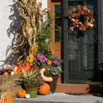 Holly's front entry features a pumpkin and black color scheme, which provides the perfect backdrop for her harvest/Halloween décor. Tim likes such an approach to decorating. Halloween elements can easily be added and removed, enabling such displays to be on view from mid-September to Thanksgiving.