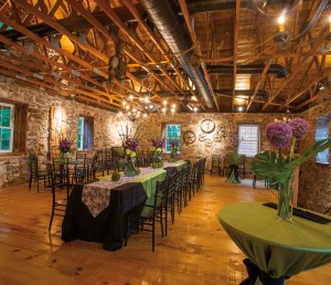 The second floor serves as the venue's ballroom. Artwork consists of implements that are original to the mill. Note the tin chandeliers crafted by Charles Messner. Claudia Himes of Special Occasions & Queen Street Linens is the exclusive linens supplier for Bear Mill. Rettew's Catering is the preferred caterer for the venue. Note Kerry's early-fall floral designs.