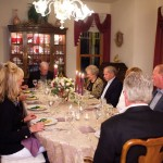 Host Charles Frey (at far head of table) welcomed his guests to the dinner for which he placed the winning bid during Water Street Mission's Top Chef Dinner & Auction.