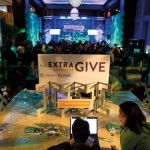 """Party attendees took advantage of """"giving stations"""" to make donations to their favorite causes."""