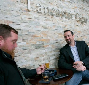 Friends James Diener (left) and Mike Cardina like the fact that Lancaster Cigar Bar provides a setting in which they can smoke cigars, enjoy a beer or cocktail and sample the tapas-inspired menu.