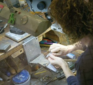 Koser Jewelers head goldsmith Beth de Vitry hand fabricates a custom necklace that was being presented as a gift.