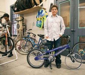 Older kids (12-17) can spend the summer learning the nuts and bolts of bikes through The Common Wheel. At the end of the session, a participant leaves with a lock, helmet and bike. Photo courtesy of The Common Wheel.