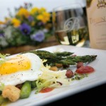 Spring on a Plate: This salad is composed of roasted asparagus, warm tasso ham, lemon tomato jam, frisee lettuce, brioche croutons and chimichurri. The finishing touch is a sunny-side-up  egg. A white wine from  Thorn Hill Vineyards  accompanies it.