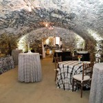 """The catacombs at Excelsior were dressed for a """"guy"""" party in plaids and gray tones by Special Occasions. Strategic lighting added drama to the unique space. (Photo credit: Adam Sinners)"""