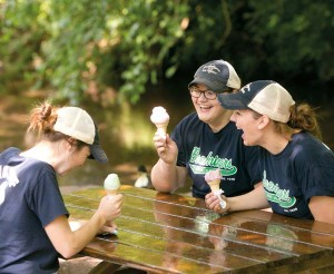 Employees enjoy an ice cream break at one of the picnic tables that offers a view of Little Muddy Creek.
