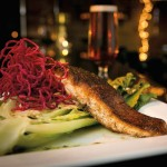Blackened salmon is served with grilled romaine and deep-fried beets. The Stockyard once again earned an Award of Excellence from Wine Spectator.