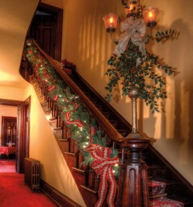 Guests for last year's house tour were greeted by this festively decorated staircase.