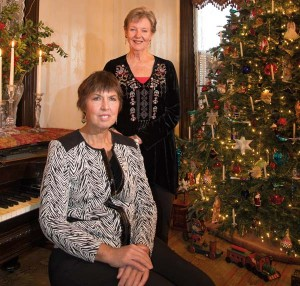 Dawn Fisher (seated) and Jeanne Fisher collaborated on decorating Jeanne's home for last year's Columbia Victorian Christmas Tour. An interesting tidbit: In the Victorian era, shopkeepers attracted business by rewarding customers who purchased items with free candles.