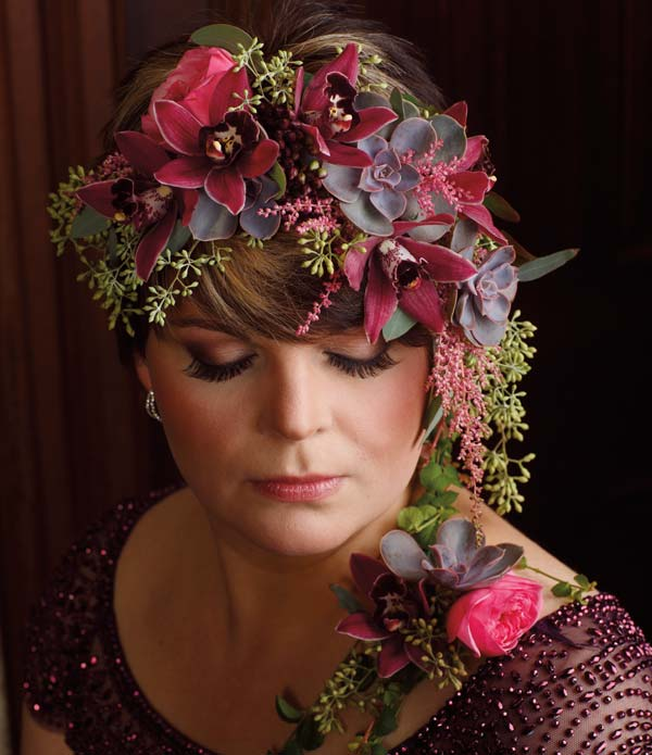 Opposite: Jill and Kristen Buckwalter of Unfading Beauty by Kristen devised this cascading crown that is comprised of succulents, orchids, garden roses, astilbe and seeded eucalyptus.