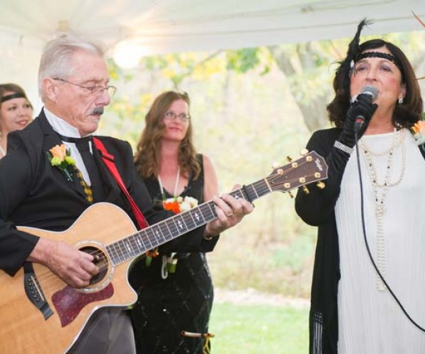 The bride's father provided accompaniment for Mary Ann Garrett's rendition of The Wedding Song.