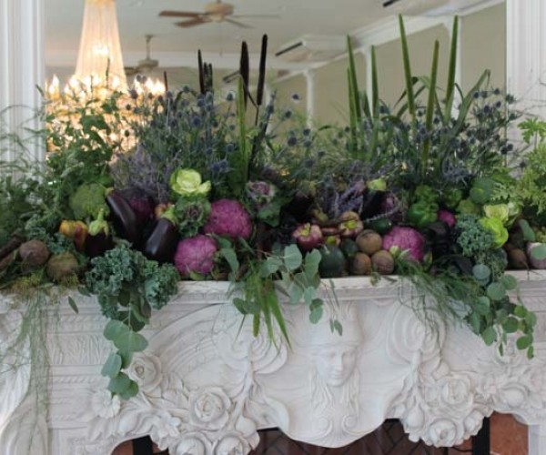 The inn's fireplaces and dining tables were topped with arrangements that included ornamental cabbage, kale, organic vegetables, eucalyptus, thistle, reeds, fiddlehead ferns and herbs.