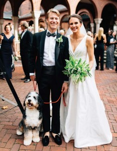 The couple's dog, Otis, was on hand to greet guests and pose for post-ceremony photographs.