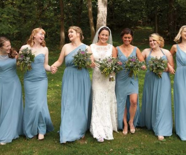 """Lauren's attendants wore various styles of dresses that were unified by the color """"Once Upon a Time"""" blue."""