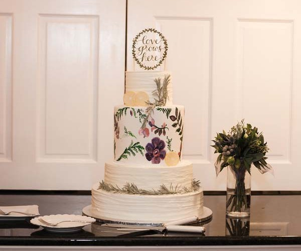 The cake, with its hand-painted flowers, also alluded to gardening/farming.