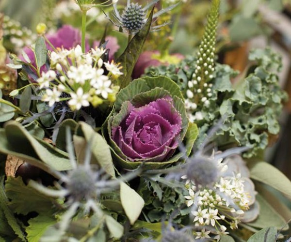 Ornamental cabbage, kale and herbs, which alluded to Lauren's love of farming, comprised the bouquets.