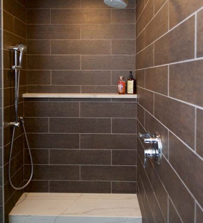 The Bronze Tile That Comprises The Walk In Shower Has A Wood Like Texture The Tower Provides Added Storage For Towels Note The Custom Glass Wood Sliding