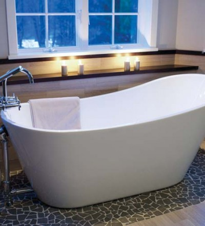 The soaking tub rests upon a stone rug. The design is repeated on the floor of the shower.