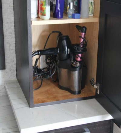 Outlets located inside the cabinets help to keep the bath clutter-free.