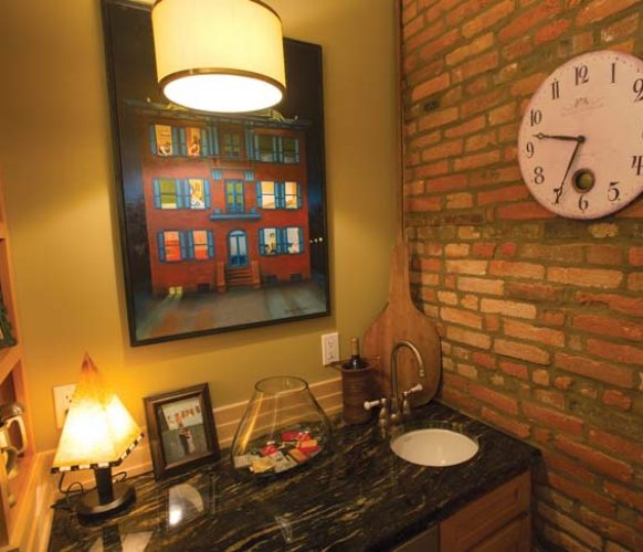 """The painting of Bube's Hotel has sentimental value, as Sheri's grandmother lived down the street from the Mount Joy landmark. Sheri purchased it at an auction that followed an Art Walk event in town. """"The auction provided seed money for a revitalization project,"""" she explains. The second-floor wet bar was carved from space that was once a closet."""