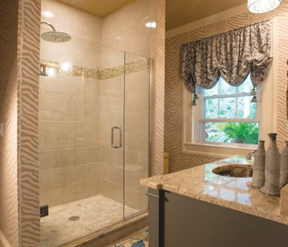 The existing second-floor bathroom was redesigned to accommodate a spa-like shower (it replaced a claw-foot tub) and full laundry.