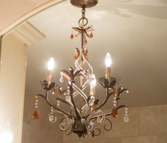 This chandelier has followed Sheri from home to home. It now hangs in the master bathroom.