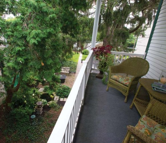 The balcony off the master suite provides a relaxing spot for starting or ending the day. It offers a commanding view of the gardens and backyard.  4. Sheri's shop and studio fill the space that was once home to Koser Jewelers.