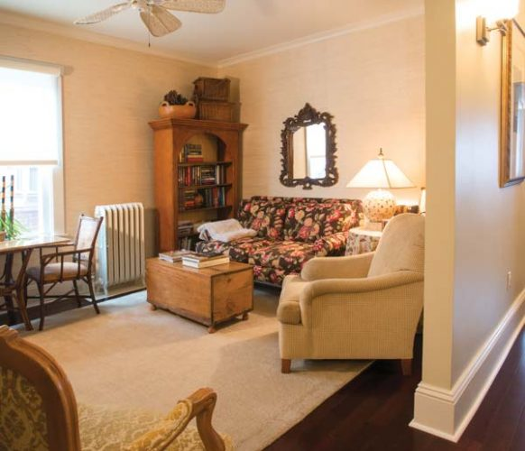 In order to create a second-floor sitting room, Sheri replaced the standard doorway with an alcove entrance. The hardwood floors weren't salvageable, so she elected to replace them with manufactured hardwood.