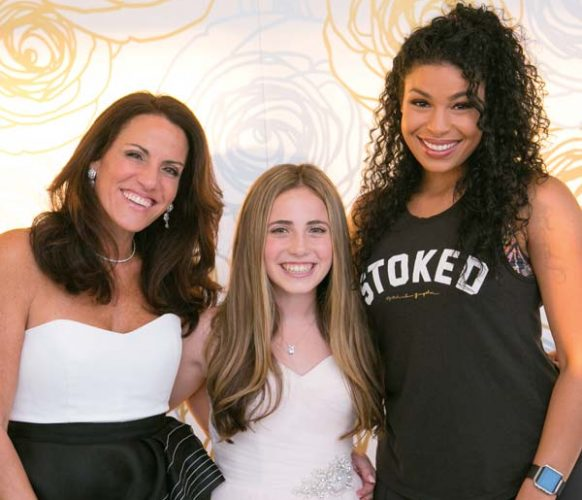 Tracy and center-of-the-party Sloane pose with the personally selected entertainer – Jordin Sparks