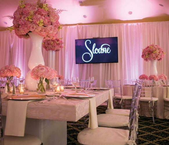 Bent Creek's ballroom was totally transformed with blush-pink fabric, specialty lighting, dramatic coordinating floral arrangements and chic décor.