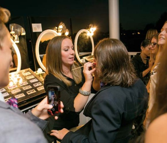 Professional makeup artists provided fun assistance – including pink eyelashes and henna tattoos – to party goers.