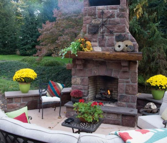 A concrete pad expanded the deck and provides a sitting area whose focal point is the fireplace that Dwight designed using sandstone from razed farm buildings.