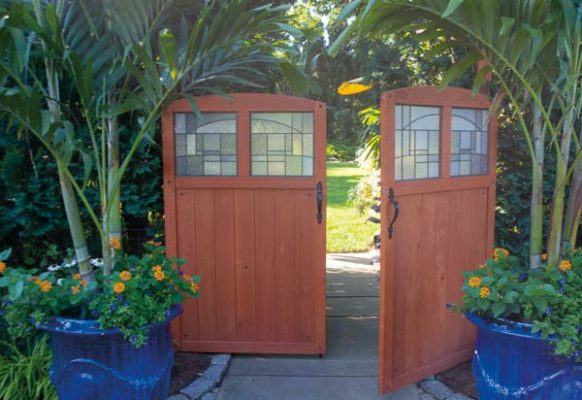 Tim and James spied these doors at Lowe's and thought they would provide the perfect entrance to the backyard gardens. They're flanked by Tim's signature container gardens.