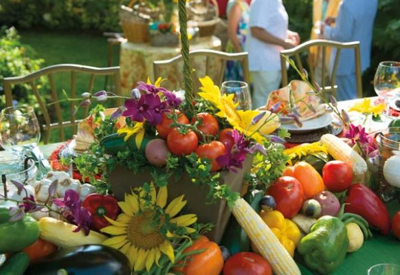 The dinner table was laden with vegetables, flowers and topiaries. At the end of the evening, guests were provided with baskets they could fill with the vegetables from the table.