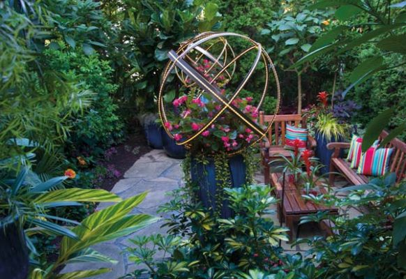 One of the property's secret gardens is illuminated by metal spheres that Tim designed.