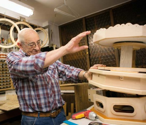 Larry at work on a carousel in his basement workshop.