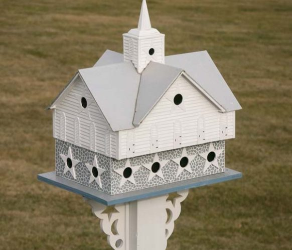Larry's Star Barn birdhouse was designed with purple martins in mind. Popsicle sticks are among the building materials Larry uses to construct the birdhouses.