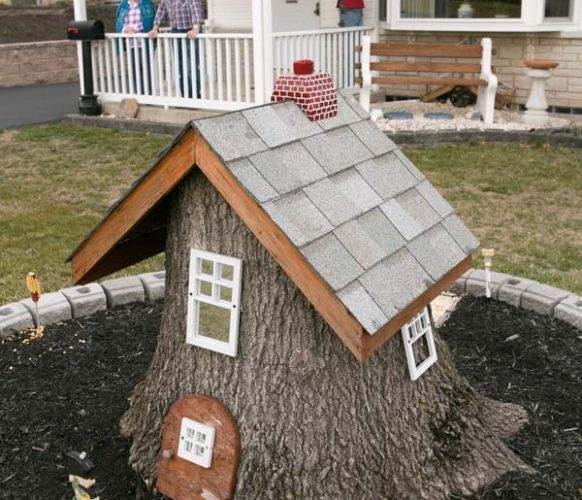 When one of Retta's favorite trees had to be cut down, Larry gave it new life as a home for gnomes.