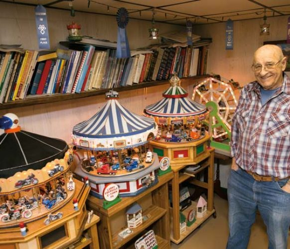 A ferris wheel and several of Larry's carousels/merry-go-rounds are on display in the Ebersoles' home.