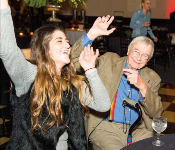 Sydney and her grandfather, Bob Groff, groove to the music.