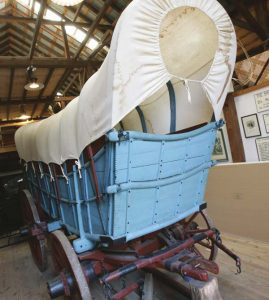 """Historians can't explain the reason for the red, white and blue color scheme of Conestoga wagons, but considering that they were the transportation """"workhorses"""" of the American Revolution, it's very appropriate. According to the U.S. Army Transportation Museum, investing in a Conestoga Wagon in the 18th century was costly: $250 for a wagon and $1,200 for the special horses that pulled it. In 21st-century terms, that equates to the cost of a modern-day tractor-trailer. This wagon was photographed at the Conestoga Area Historical Society's museum."""