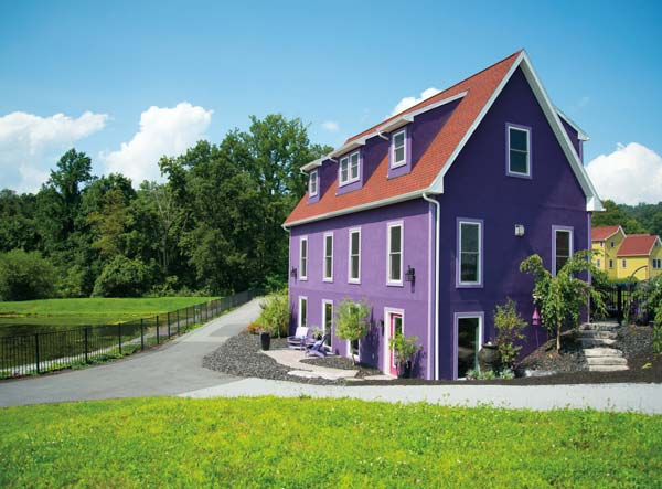 "Downsizing led Terry and Becky McKim to Stoudtburg Village in Adamstown. Their distinctive purple house attracts droves of picture takers – ""It's very popular with Baltimore Ravens fans,"" Terry reports. While there are several outdoor-living areas, there isn't a blade of grass to cut."